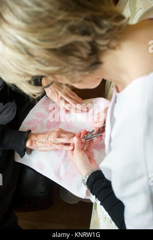 Aubigny-en-Artois (northern France). 2015/01/19. Nursing home for dependent elderly persons (French 'EHPAD'). Manicure. - Stock Photo