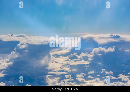 Above Clouds Airplane Window Blue Daytime Fluffy Column Wispy White Puffy - Stock Photo