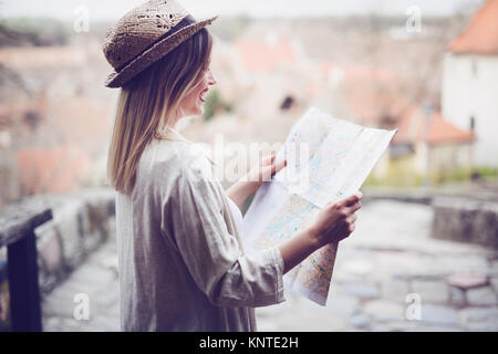 Happy female tourist sightseeing and exploring - Stock Photo