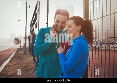 Sportsman and sportswoman flirting outdoor after fitness exercis - Stock Photo