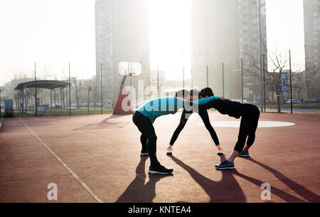 Friends fitness training together outdoors living active healthy - Stock Photo