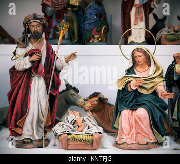 some classical figurines depicting the Holy Family, the Child Jesus, the Virgin Mary and Saint Joseph, and the donkey - Stock Photo