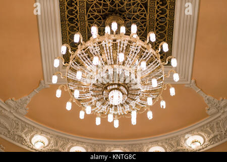 Chandelier on decoarted ceiling of a ballroom - Stock Photo