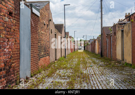 backs of derelict terraced houses England Hartlepool england abandoned houses ready for demolition or redevelopment - Stock Photo