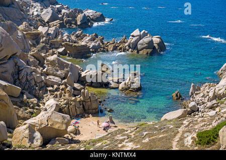 Tiny beach surrounded of granite boulders at Capo Testa, Santa Teresa di Gallura, Sardinia, Italy, Mediterranean - Stock Photo