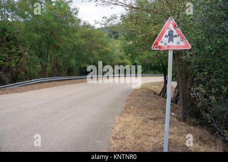 Riddled traffic sign at a road, Gallura, Sardinia, Italy, Mediterranean sea, Europe - Stock Photo