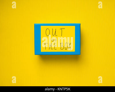 Closed Blue box on yellow background. Out of the box concept - Stock Photo