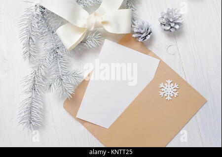Mockup christmas greeting card letter in envelope with white tree mockup christmas greeting card letter in envelope with white tree and cone flatlay on a m4hsunfo