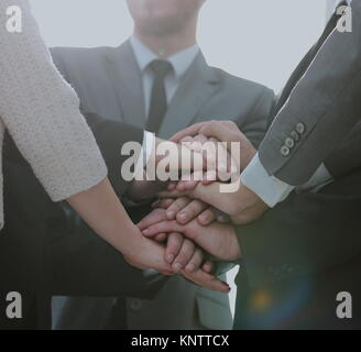 Close up top view of business people putting their hands togethe - Stock Photo