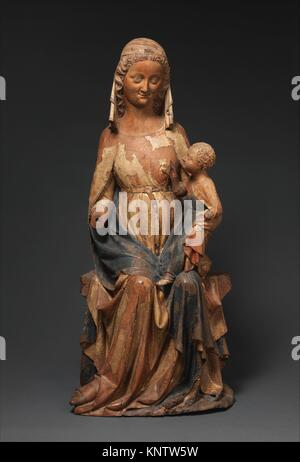 Seated Virgin and Child. Date: ca. 1300-1350; Geography: Made in Ile-de-France, France; Culture: French; Medium: - Stock Photo