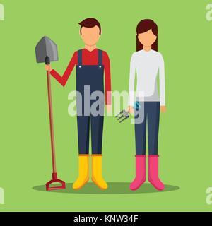 gardeners couple holding shovel and pichfork tools - Stock Photo