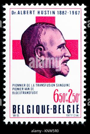 Belgian postage stamp (1977) : Albert Hustin (1882-1967) Belgian doctor, pioneer of blood transfusion, the first - Stock Photo
