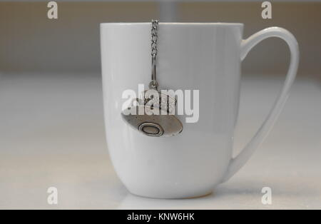 big white cup of tea - Stock Photo