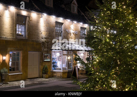 Christmas tree and decorations at night in front of The Old stocks inn. Stow on the Wold, Cotswolds, Gloucestershire, - Stock Photo