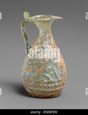 Ewer with Molded Inscription. Object Name: Ewer; Date: 9th century; Geography: Probably made in Iraq; Medium: Glass, - Stock Photo