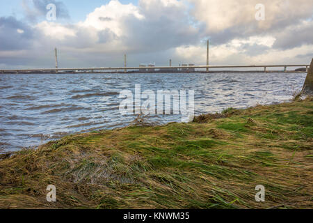 Looking out across the River Mersey at the old Runcorn Silver Jubilee Bridge and the new Mersey Gateway Bridge - Stock Photo