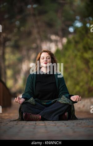 Harmony, Woman Meditates in the Park - Stock Photo