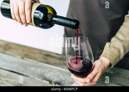 sommelier pouring red wine into glass  Stock Photo
