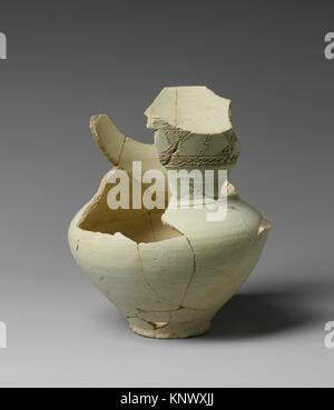 Three Unglazed Pitchers and a Lid. Object Name: Ewer; Date: 9th century; Geography: Excavated in Iran, Nishapur; - Stock Photo