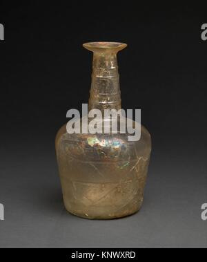 Flask. Date: 9th century; Geography: Excavated in Iran, Nishapur; Medium: Glass; free blown, cut; Dimensions: H. - Stock Photo