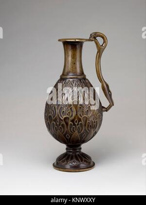 Ewer with a Feline-Shaped Handle. Object Name: Ewer; Date: 7th century; Geography: Attributed to Iran; Medium: Bronze; - Stock Photo