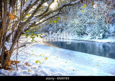 Frozen canal and snow covered bank in Birmingham - Stock Photo
