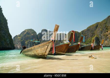 Longtail boats anchored at Maya Bay on Phi Phi Leh Island, Krabi Province, Thailand. It is part of Mu Ko Phi Phi - Stock Photo
