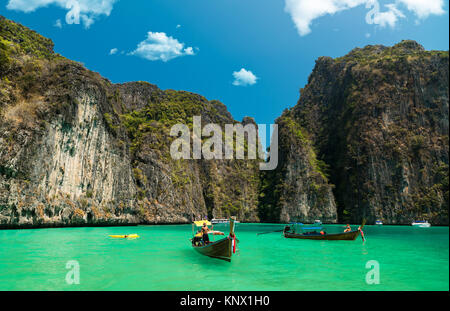 Longtail boats anchored at Maya Bay on Phi Phi Leh Island, Krabi Province, Thailand. It is part of Mu Ko Phi Phi - Stock Photo