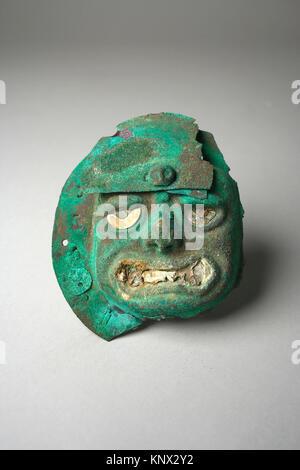 Face Mask Ornament. Date: 390-450; Geography: Peru; Culture: Moche (Loma Negra); Medium: Silvered copper, shell; - Stock Photo