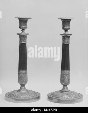 Pair of candlesticks. Date: ca. 1815-30; Culture: French; Medium: Bronze, parcel gilt; Dimensions: Height (each): - Stock Photo