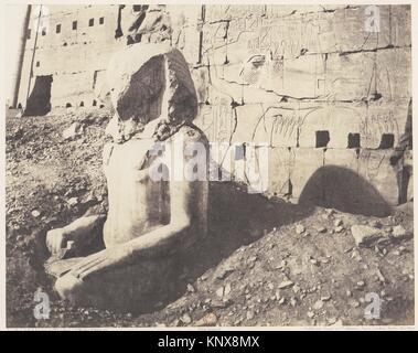 Karnak (Thèbes), Troisième Pylône - Colosse de Spath Calcaire, en D. Artist: Félix Teynard (French, 1817-1892); - Stock Photo