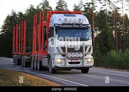 SALO, FINLAND - NOVEMBER 17, 2017: White Iveco Stralis 560 logging truck of Puukuljetus Hans Funck on rural road - Stock Photo