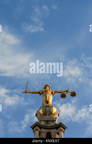 Lady Justice Statue With Space For Text In The Sky Above - Stock Photo