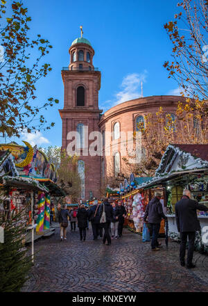 Germany, Frankfurt am Main,Traditional German Christmas market with stalls selling gifts and food outside Paulskirche, - Stock Photo