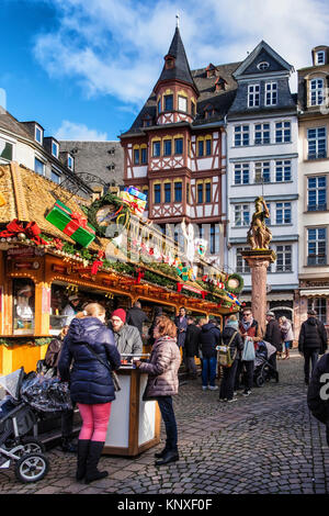 Frankfurt,Germany. Traditional German Market stalls on Römerberg with historic half-timber terraced houses, - Stock Photo