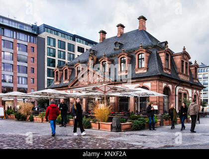 Frankfurt,Germany.People walk past Historic old Main Guard House building on Hauptwache square now a cafe, restaurant - Stock Photo