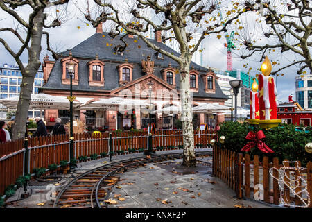 Frankfurt,Germany.Miniature railway tracks & Historic old Main Guard House building on Hauptwache square now a cafe, - Stock Photo