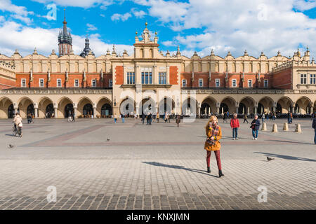 Krakow Cloth Hall, the grand Market Square and the west side of the 16th Century Cloth Hall (Sukiennice) in the - Stock Photo