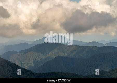 Cumulus clouds forming over the Cordillera del Condor on the border of Ecuador with Peru. This pristine mountain - Stock Photo
