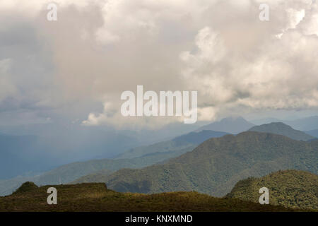 Clouds forming over the Cordillera del Condor on the border of Ecuador with Peru. This pristine mountain range is - Stock Photo