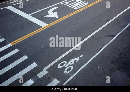 looking down on street traffic markings at New York City intersection - Stock Photo