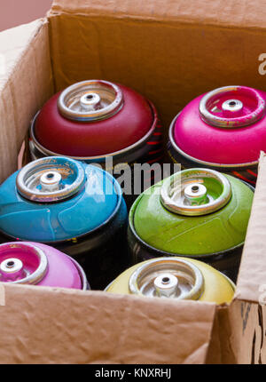 Box full of colored spray cans ready to use. - Stock Photo