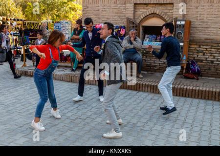 Uzbek People Dancing In The Street, Khiva, Uzbekistan - Stock Photo