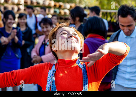 A Young Uzbek Woman Dancing In The Street, Khiva, Uzbekistan - Stock Photo