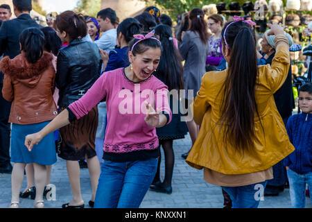 Young Uzbek People Dancing In The Street, Khiva, Uzbekistan - Stock Photo