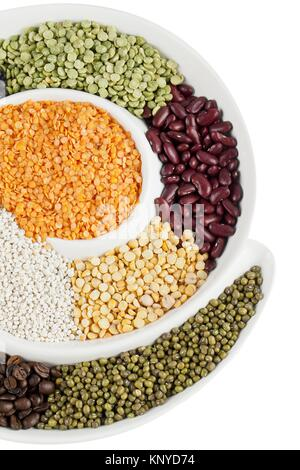assorted beans in circular bowl - Stock Photo