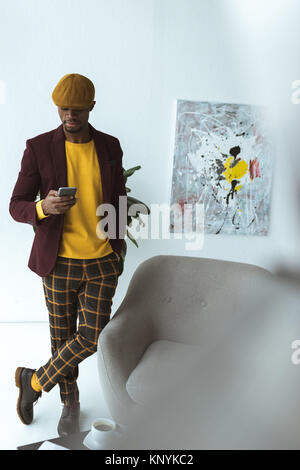 handsome african american businessman with smartphone - Stock Photo