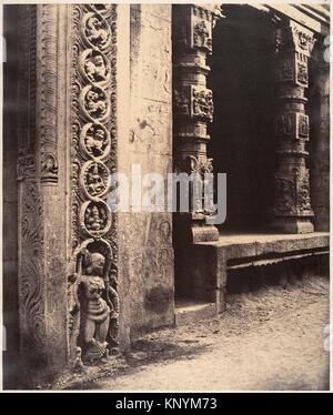 Pillars in the Recessed Portico in the Roya Gopuram with the Base of One of the Four Sculptured Monoliths, Madura. - Stock Photo
