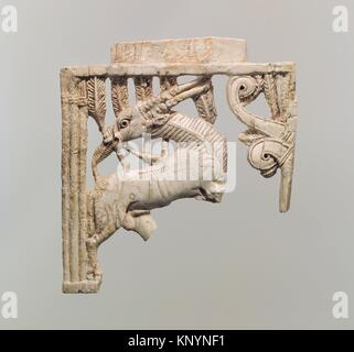 Openwork furniture plaque with a grazing oryx in a forest of fronds. Period: Neo-Assyrian; Date: ca. 9th-8th century - Stock Photo