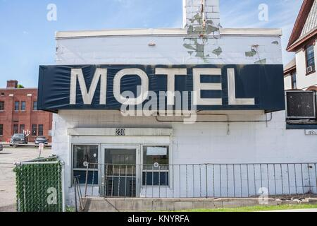 '''''Motel'' sign on an old, abandoned motel. - Stock Photo
